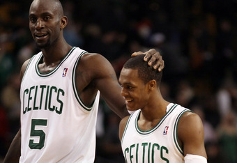 BOSTON, MA - MARCH 06: Kevin Garnett #5 of the Boston Celtics celebrates the win with teammate Rajon Rondo #9 on March 6, 2012 at TD Garden in Boston, Massachusetts. The Boston Celtics defeated the Houston Rockets 97-92 in overtime. NOTE TO USER: User exp