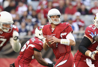 GLENDALE, AZ - DECEMBER 04:  Quarterback Kevin Kolb #4 of the Arizona Cardinals drops back to pass during the NFL game against the Dallas Cowboys at the University of Phoenix Stadium on December 4, 2011 in Glendale, Arizona.  The Cardinals defeated the Co