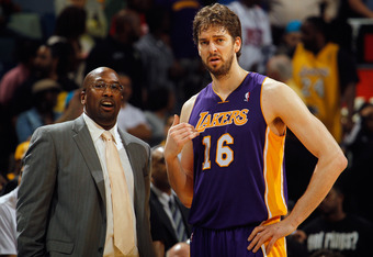 NEW ORLEANS, LA - MARCH 14:  Pau Gasol #16 talks with head coach Mike Brown of the Los Angeles Lakers during a timeout against the New Orleans Hornets at the New Orleans Arena on March 14, 2012 in New Orleans, Louisiana.  NOTE TO USER: User expressly ackn