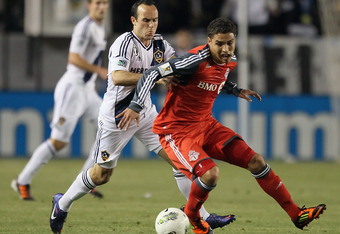 CARSON, CA - MARCH 14:  Luis Silva #11 of the Toronto FC is pursued by Landon Donovan #10 of the Los Angeles Galaxy for the ball in the second half during a CONCACAF Champions League game at The Home Depot Center on March 14, 2012 in Carson, California. T