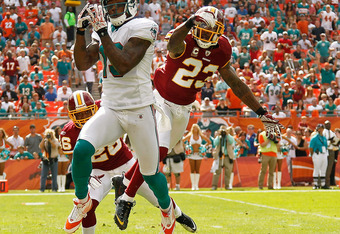 MIAMI GARDENS, FL - NOVEMBER 13:   Brandon Marshall #19 of the Miami Dolphins misses a pass guarded by  DeAngelo Hall #23 of the Washington Redskins during a game  at Sun Life Stadium on November 13, 2011 in Miami Gardens, Florida.  (Photo by Mike Ehrmann