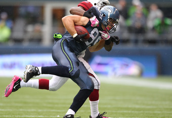 SEATTLE - OCTOBER 24:  Tight end John Carlson #89 of the Seattle Seahawks is driven out of bounds by linebacker Daryl Washington #58 of the Arizona Cardinals at Qwest Field on October 24, 2010 in Seattle, Washington. (Photo by Otto Greule Jr/Getty Images)