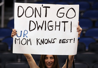 ORLANDO, FL - MARCH 13:  A fan holds a sign in support of Dwight Howard #12 of the Orlando Magic during the game against the Miami Heat at Amway Center on March 13, 2012 in Orlando, Florida.  NOTE TO USER: User expressly acknowledges and agrees that, by d