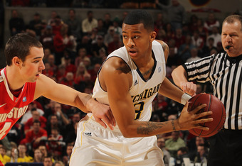 INDIANAPOLIS, IN - MARCH 10:  Trey Burke #3 of the Michigan Wolverines looks to pass against Aaron Craft #4 of the Ohio State Buckeyes during their Semifinal game of the 2012 Big Ten Men's Basketball Conference Tournament at Bankers Life Fieldhouse on Mar