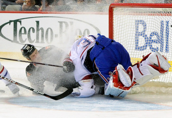 MONTREAL, CANADA - MARCH 14:  Chris Neil #25 of the Ottawa Senators collides with Carey Price #31 of the Montreal Canadiens during the NHL game at the Bell Centre on March 14, 2012 in Montreal, Quebec, Canada.  The Canadiens defeated the Senators 3-2 in a