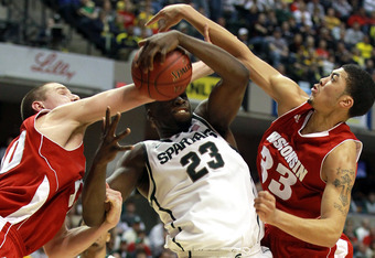INDIANAPOLIS, IN - MARCH 10:  Draymond Green #23 of the Michigan State Spartans attempts to control a rebound against Rob Wilson #33 and Jared Berggren #40 of the Wisconsin Badgers during their Semifinal game of the 2012 Big Ten Men's Basketball Conferenc