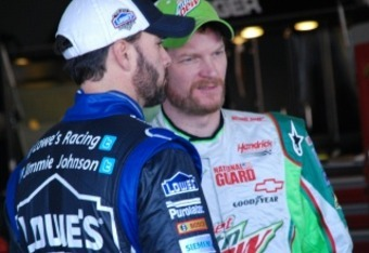 Dale Earnhardt Jr. talks to Jimmie Johnson in the Daytona garage.