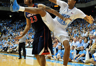 Virginia's Mike Scott, left, boxes out North Carolina's John Henson.