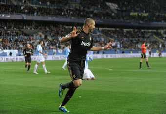 MALAGA, SPAIN - JANUARY 10:  Karim Benzema of Real Madrid celebrates after scoring Real's opening goal during the round of 16 Copa del Rey second leg match between Real Madrid and Malaga at La Rosaleda Stadium on January 10, 2012 in Malaga, Spain.  (Photo