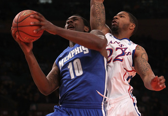 NEW YORK, NY - DECEMBER 07:  Tarik Black #10 of the Memphis Tigers shoots the ball against Marcus Morris #22 of the Kansas Jayhawks during their game at the Jimmy V Classic at Madison Square Garden on December 7, 2010 in New York City.  (Photo by Nick Lah