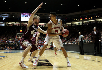 ALBUQUERQUE, NM - MARCH 15:  Ryan Evans #5 of the Wisconsin Badgers looks to pass against Mathias Ward #40 of the Montana Grizzlies in the first half during the second round of the 2012 NCAA Men's Basketball Tournament at The Pit on March 15, 2012 in Albu