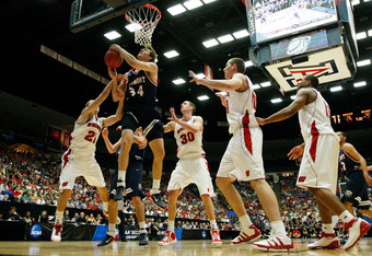 TUCSON, AZ - MARCH 17:  Mick Hedgepeth #34 of the Belmont Bruins shoots against the Wisconsin Badgers during the second round of the 2011 NCAA men's basketball tournament at McKale Center on March 17, 2011 in Tucson, Arizona.  (Photo by Harry How/Getty Im