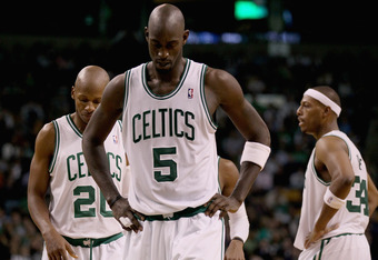 BOSTON, MA - JANUARY 06:  Kevin Garnett #5, Ray Allen #20 and Paul Pierce #34 of the Boston Celtics react in the fourth quarter against the Indiana Pacers on January 6, 2012 at TD Garden in Boston, Massachusetts. The Indiana Pacers defeated the Boston Cel