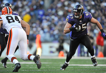 BALTIMORE - DECEMBER 24:  Jarret Johnson #95 of the Baltimore Ravens defends against the Cleveland Browns at M&T Bank Stadium on December 24, 2011 in Baltimore, Maryland. The Ravens defeated the Browns 20-14. (Photo by Larry French/Getty Images)