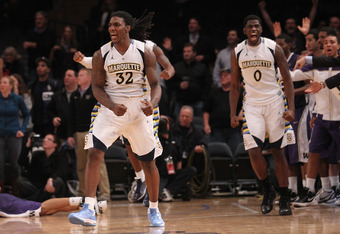 NEW YORK, NY - DECEMBER 06:  Jae Crowder #32 and Jamil Wilson #0 of the Marquette Golden Eagles celebrate defeating the Washington Huskies during the Jimmy V Men's Basketball Classic at Madison Square Garden on December 6, 2011 in New York City.  (Photo b