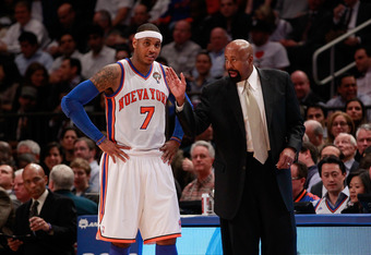 NEW YORK, NY - MARCH 14:  (R) Mike Woodson the interim head coach of the New York Knicks coaches (L) Carmelo Anthony #7 of the New York Knicks  during the game against the Portland Trailblazers at Madison Square Garden on March 14, 2012 in New York City.
