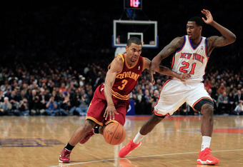 NEW YORK, NY - FEBRUARY 29: Ramon Sessions #3 of the Cleveland Cavaliers drives against Iman Shumpert #21 of the New York Knicks at Madison Square Garden on February 29, 2012 in New York City. NOTE TO USER: User expressly acknowledges and agrees that, by
