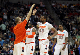 PITTSBURGH, PA - MARCH 15:  James Southerland #43 of the Syracuse Orange celebrates with his teammates after a point against the UNC Asheville Bulldogs during the second round of the 2012 NCAA Men's Basketball Tournament at Consol Energy Center on March 1