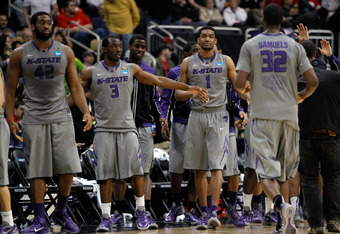 PITTSBURGH, PA - MARCH 15:  Martavious Irving #3 of the Kansas State Wildcats celebrates with teammates Shane Southwell #1 and Jamar Samuels #32 after defeating the Southern Miss Golden Eagles during the second round of the 2012 NCAA Men's Basketball Tour