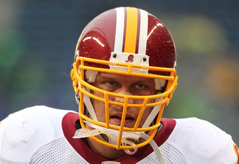 SEATTLE, WA - NOVEMBER 27:  Adam Carriker #94 of the Washington Redskins looks on prior to the game against the Seattle Seahawks at CenturyLink Field on November 27, 2011 in Seattle, Washington. (Photo by Otto Greule Jr/Getty Images)