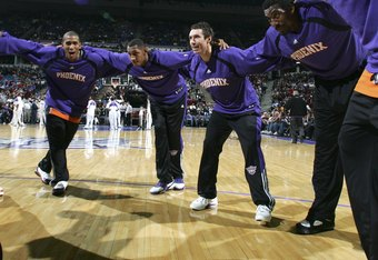 SACRAMENTO, CA - DECEMBER 16:  Raja Bell #19, Boris Diaw #3, Steve Nash #13 and Amare Stoudemire #1 of the Phoenix Suns warm up before their game against the Sacramento Kings during an NBA game at Arco Arena December 16, 2006 in Sacramento, California.  N
