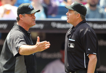 TORONTO,CANADA - AUGUST 13:  Toronto Blue Jay's manager John Farrell #52 argues a call with home umpire Gary Darling against the Los Angeles Angels of Anaheim in a MLB game on August 13,2011 at the Rogers Centre in Toronto, Canada. (Photo by Claus Anderse