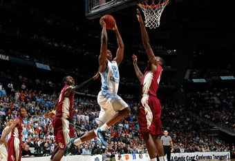 ATLANTA, GA - MARCH 11:  Harrison Barnes #40 of the North Carolina Tar Heels drives for a dunk attempt against Bernard James #5 of the Florida State Seminoles during the Final Game of the 2012 ACC Men's Basketball Conference Tournament at Philips Arena on