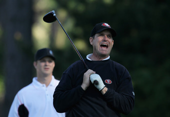 PEBBLE BEACH, CA - FEBRUARY 09:  San Francisco 49ers head coach Jim Harbaugh reacts to his tee shot on the 18th hole during the first round of the AT&T Pebble Beach National Pro-Am at the Spyglass Hill Golf Course on February 9, 2012 in Pebble Beach, Cali