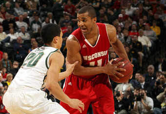 INDIANAPOLIS, IN - MARCH 10:  Jordan Taylor #11 of the Wisconsin Badgers looks to pass in the first half against Travis Trice #20 of the Michigan State Spartans during their Semifinal game of the 2012 Big Ten Men's Basketball Conference Tournament at Bank