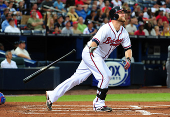ATLANTA - JUNE 18: Brian McCann #16 of the Atlanta Braves hits a home run against the Texas Rangers at Turner Field on June 18, 2011 in Atlanta, Georgia. (Photo by Scott Cunningham/Getty Images)