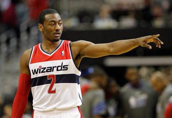 WASHINGTON, DC - JANUARY 30: John Wall #2 of the Washington Wizards points to the bench during the first half against the Chicago Bulls at Verizon Center on January 30, 2012 in Washington, DC. NOTE TO USER: User expressly acknowledges and agrees that, by