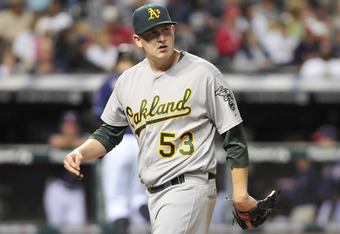 CLEVELAND, OH - AUGUST 30: Starting pitcher Trevor Cahill #53 of the Oakland Athletics looks to the scoreboard as he walks off the field after giving up a two run home run during the sixth inning against the Cleveland Indians at Progressive Field on Augus