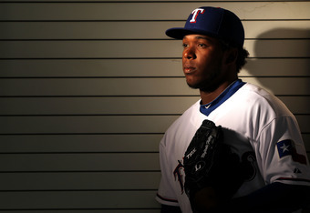SURPRISE, AZ - FEBRUARY 28:  Neftali Feliz #30 of the Texas Rangers poses during spring training photo day on February 28, 2012 in Surprise, Arizona.  (Photo by Jamie Squire/Getty Images)