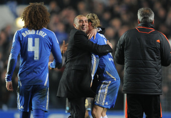 LONDON, ENGLAND - MARCH 14:  Roberto Di Matteo caretaker manager of Chelsea celebrates victory with Fernando Torres after the UEFA Champions League Round of 16 second leg match between Chelsea FC and SSC Napoli at Stamford Bridge on March 14, 2012 in Lond