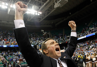 GREENSBORO, NC - MARCH 16:  Head coach Brett Reed of the Lehigh Mountain Hawks reacts after the Mountain Hawks defeat the db 75-70 during the second round of the 2012 NCAA Men's Basketball Tournament at Greensboro Coliseum on March 16, 2012 in Greensboro,