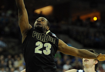 OMAHA, NE - MARCH 16:  Lewis Jackson #23 of the Purdue Boilermakers attempts a shot against Rob Jones #22 and Clint Steindl #11 of the St. Mary's Gaels during the second round of the 2012 NCAA Men's Basketball Tournament at CenturyLink Center on March 16,