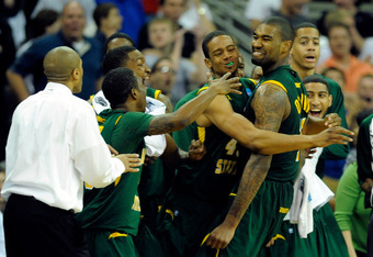 OMAHA, NE - MARCH 16:  Kyle O'Quinn #10 (R) of the Norfolk State Spartans celebrates with his teammates on the bench late in the second half against the Missouri Tigers during the second round of the 2012 NCAA Men's Basketball Tournament at CenturyLink Ce