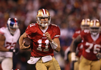 SAN FRANCISCO, CA - JANUARY 22:  Alex Smith #11 of the San Francisco 49ers runs the ball during the second half of the NFC Championship Game against the New York Giants at Candlestick Park on January 22, 2012 in San Francisco, California.  (Photo by Ezra