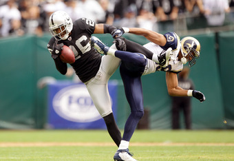 OAKLAND, CA - SEPTEMBER 19:  Stanford Routt #26 of the Oakland Raiders intercepts a pass intended for Laurent Robinson #19 of the St. Louis Rams at the Oakland-Alameda County Coliseum on September 19, 2010 in Oakland, California.  (Photo by Ezra Shaw/Gett