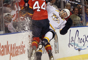 Erik Gudbranson laying the body on the Predators