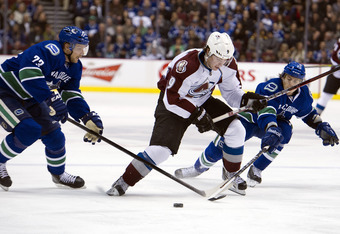 Matt Duchene breaking through two Canuck defenders