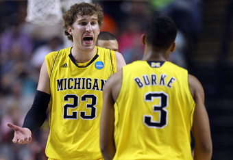 NASHVILLE, TN - MARCH 16:  Evan Smotrycz #23 of the Michigan Wolverines talks with Trey Burke #3 of the Michigan Wolverines against the Ohio Bobcats during the second round of the 2012 NCAA Men's Basketball Tournament at Bridgestone Arena on March 16, 201