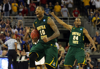 OMAHA, NE - MARCH 16:  Kyle O'Quinn #10 and Brandon Wheeless #24 of the Norfolk State Spartans celebrate after they won 86-84 against the Missouri Tigers during the second round of the 2012 NCAA Men's Basketball Tournament at CenturyLink Center on March 1