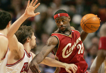 CHICAGO - MARCH 31:  Andres Nocioni #5 of the Chicago Bulls pressures LeBron James #23 of the Cleveland Cavaliers on March 31, 2005 at the United Center in Chicago, Illinois. The Bulls defeated the Cavs 102-90 in overtime.  NOTE TO USER: User expressly ac
