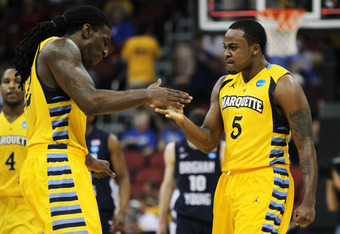 LOUISVILLE, KY - MARCH 15:  Junior Cadougan #5 and Jae Crowder #32 of the Marquette Golden Eagles reacts after a play against the Marquette Golden Eagles during the second round of the 2012 NCAA Men's Basketball Tournament at KFC YUM! Center on March 15,