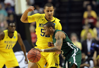 NASHVILLE, TN - MARCH 16:  D.J. Cooper #5 of the Ohio Bobcats drives the ball against Jordan Morgan #52 of the Michigan Wolverines during the second round of the 2012 NCAA Men's Basketball Tournament at Bridgestone Arena on March 16, 2012 in Nashville, Te