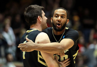 ALBUQUERQUE, NM - MARCH 15: Nate Tomlinson #1 and Carlon Brown #30 of the Colorado Buffaloes celebrate after defeating the UNLV Rebels during the second round of the 2012 NCAA Men's Basketball Tournament at The Pit on March 15, 2012 in Albuquerque, New Me