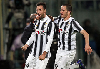 FLORENCE, ITALY - MARCH 17: Mirko Vucinic (L) of Juventus FC celebrates after scoring a goal during the Serie A match between ACF Fiorentina and Juventus FC at Stadio Artemio Franchi on March 17, 2012 in Florence, Italy.  (Photo by Gabriele Maltinti/Getty