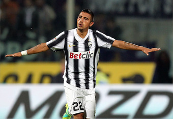 FLORENCE, ITALY - MARCH 17: Arturo Vidal of Juventus FC celebrates after scoring a goal during the Serie A match between ACF Fiorentina and Juventus FC at Stadio Artemio Franchi on March 17, 2012 in Florence, Italy.  (Photo by Gabriele Maltinti/Getty Imag