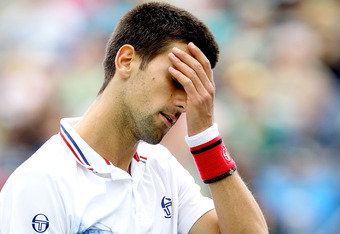INDIAN WELLS, CA - MARCH 17:  Novak Djokovic of Serbia reacts to a lost point against John Isner during the semifinal of the BNP Paribas Open at the Indian Wells Tennis Garden on March 17, 2012 in Indian Wells, California.  (Photo by Matthew Stockman/Gett